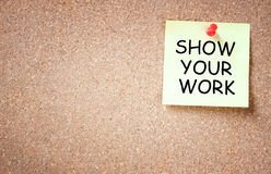 Sticky note pined to cork board with the phrase show your work written on i Royalty Free Stock Images