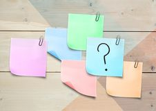 Sticky Note with Question Icon against a wood wall Stock Images