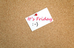 Sticky Note It's Friday Concept. Sticky Note On Cork Board Background It's Friday Concept royalty free stock photography