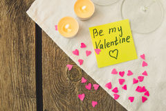 Sticky note for Saint Valentine's day and tea lights copy space Royalty Free Stock Image