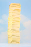 Sticky Note Sky Tower. Tower of sticky notes on sky and clouds background Stock Image