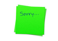 Sticky note sorry. Two green sticky notes sorry, white background Royalty Free Stock Images