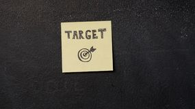 Sticky note on the blackboard. Sticky note with Target word on the blackboard Stock Image