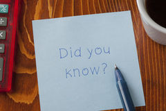 Sticky note with tex did you know. Did you know written on a note on wooden background with pen royalty free stock photos