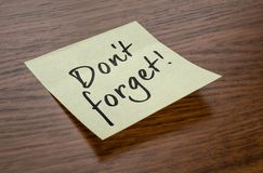 Sticky note with the text Do not forget royalty free stock photography