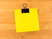 Sticky note on wooden background, empty space for text Royalty Free Stock Images
