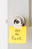 Sticky note write a message pay the rent Stock Photography