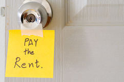 Sticky note write a message pay the rent Royalty Free Stock Images