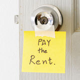 Sticky note write a message pay the rent Royalty Free Stock Photo