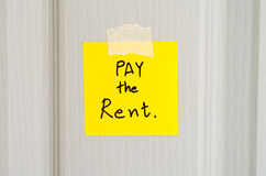 Sticky note write a message pay the rent Royalty Free Stock Photography