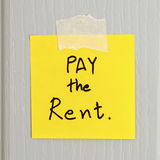 Sticky note write a message pay the rent Stock Photo
