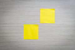 Sticky Note. Yellow sticky note attach to a wooden wall Royalty Free Stock Images