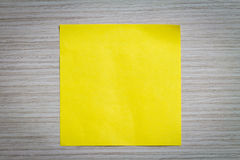 Sticky Note. Yellow sticky note attach to a wooden wall Royalty Free Stock Photos