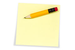 Sticky note with yellow pencil Royalty Free Stock Photography