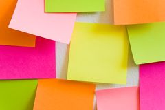 Sticky Notes. Blank sticky notes attached to a white wall. Close-up Stock Photography