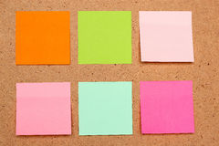 Sticky notes. Six sticky notes different colors on board Stock Images