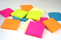 Sticky Notes. Colorful sticky notes in a pile on a white background Stock Image
