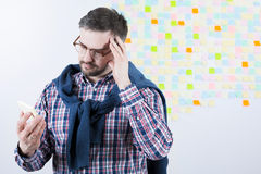 Sticky notes for better memory. Middle aged focused man trying to remember his duties. Holding sticky notes Stock Photography
