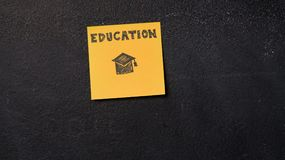 Sticky notes on the blackboard. Sticky note with Education word on the blackboard Royalty Free Stock Photography