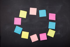 Sticky notes on the blank blackboard Royalty Free Stock Photo