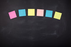 Sticky notes on the blank blackboard Stock Images