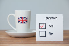Sticky notes with brexit referendum concept and union jack cup Royalty Free Stock Image
