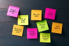 Sticky notes with busy woman schedule Stock Photos