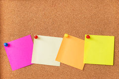 Sticky notes on cork board Royalty Free Stock Images