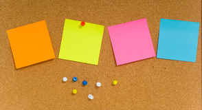 Sticky notes on cork board Royalty Free Stock Image