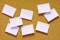 Sticky notes on corkboard Stock Image