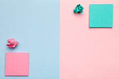 Sticky Notes with Crumbled Paper Balls on Pastel Background. Minimal style. Flat lay. Copy space. Top view Stock Photos
