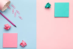 Sticky Notes with Crumbled Paper Balls on Pastel Background. Sticky notes with crumbled paper balls and office accessories on pastel background. Minimal style Royalty Free Stock Photography