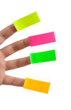 Sticky notes and fingers Stock Images