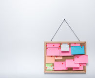Sticky notes on hanging cork bulletin Stock Photo