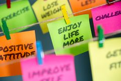 Sticky notes hanging with important message to enjoy life more stock photos