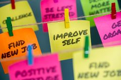 Sticky notes with improve self written stock images