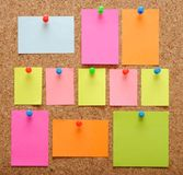 Sticky notes over brown cork Stock Images