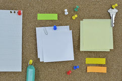 Sticky notes, pin, key and tag name on cork board Stock Photography