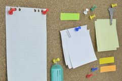 Sticky notes, pin, key and tag name on cork board Stock Image