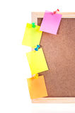 Sticky notes pinned on a cork board frame Royalty Free Stock Images