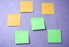 Sticky notes on purple wall. Blank colorful Sticky notes on purple wall Stock Images
