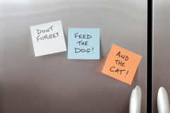 Sticky Notes on a Refrigerator. Sticky Notes on a stainless steel refrigerator royalty free stock photos