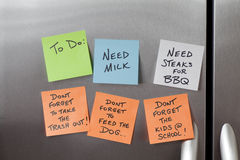 Sticky Notes on a Refrigerator. Sticky Notes on a stainless steel refrigerator stock images