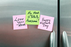 Sticky Notes on a Refrigerator. Sticky Notes on a stainless steel refrigerator stock photos