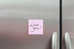 Sticky Notes on a Refrigerator. Love you Sticky Note on a stainless steel Refrigerator stock image