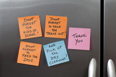 Sticky Notes on a Refrigerator. To do's & reminder sticky notes on a kitchen stainless steel refrigerator stock photo