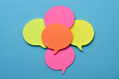 Sticky notes in the shape of speech balloons Stock Photos