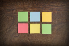 Sticky notes on wooden background Royalty Free Stock Photography