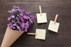 Sticky notes are on the wooden background with purple cutter flo Stock Photos