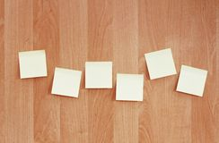 Sticky notes on wooden wall Royalty Free Stock Photos